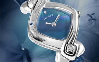 Original womens watch - Dolphin: Steel watch, blue mother-of-pearl dial, nickel-plated hands, steel cabochon with a diamond, blue alligator strap, engraved with a dolphin and set with a sapphire at 10 o'glock
