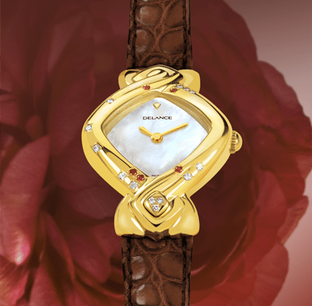 My Mother's Watch : Montre en or sertie de 12 diamants et 5 rubis, cadran nacre blanche, aiguilles dorées, cabochon avec 3 diamants en forme de cœur, bracelet en alligator rouge vin