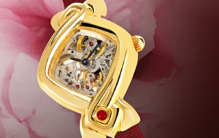 Skeleton watch for women - Dentelle in Gold: Mechanical gold watch (Piguet movement), black hands, gold cabochon with a ruby, red satin strap