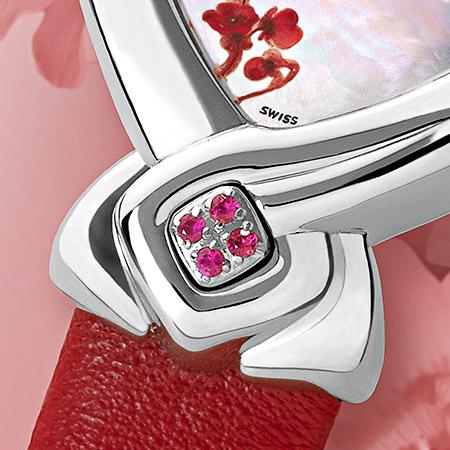 Florencia, montre Delance en acier pour une femme. Cadran de nacre blanche décoré d'une fleur rose. 4 saphirs à 6 heures et un bracelet de cuir rouge Swissmade, étanche, garantie 5 ans